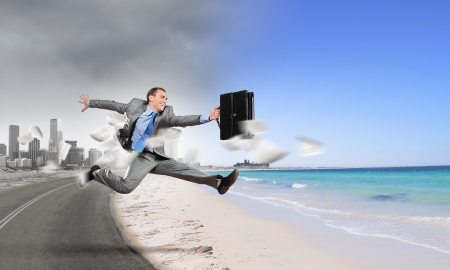 Image of businessman running away from office work Фото со стока