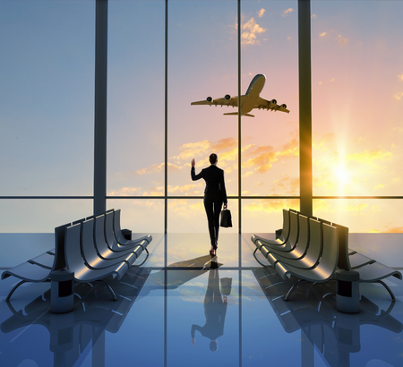 the window: Image of woman in airport looking at taking off airplane