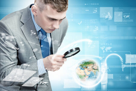 optical people person planet: Image of businessman examining objects with magnifier