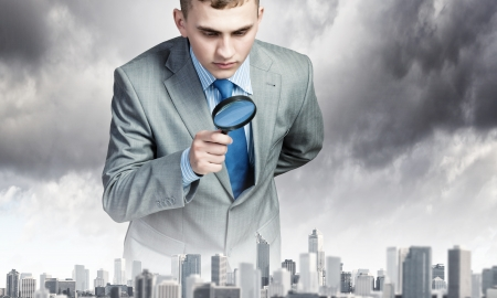 portraiture: Image of businessman examining objects with magnifier
