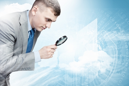 Image of businessman examining objects with magnifier photo