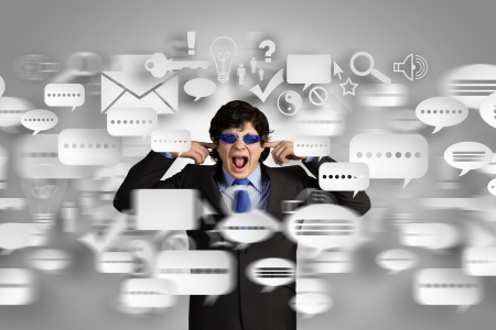 annoyance: Image of businessman stopping his ears  Long working hours Stock Photo