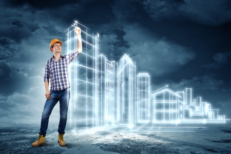 Image of man engineer against building project sketch photo