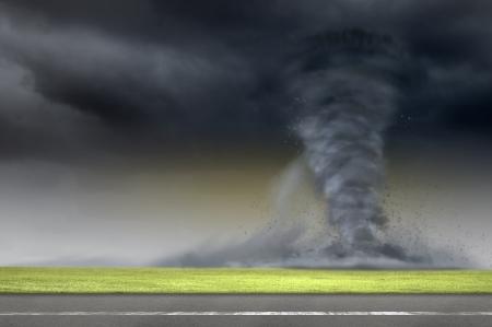 Image of powerful huge tornado twisting on road photo