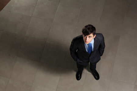 new job: Image of young businessman looking above  Top view