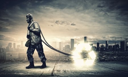 Man in respirator against catastrophe background  Recycle concept photo