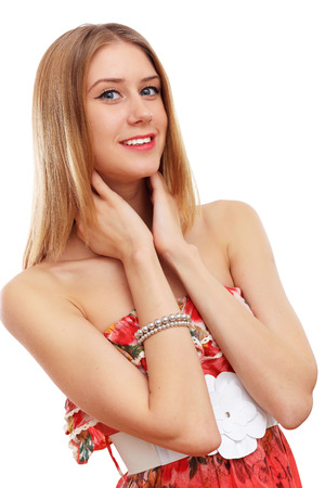 Beautiful young blond woman in red dress photo