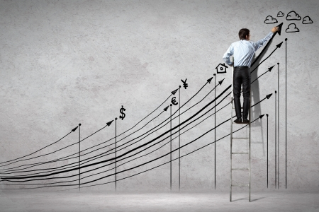success business: Back view image of businessman drawing graphics on wall
