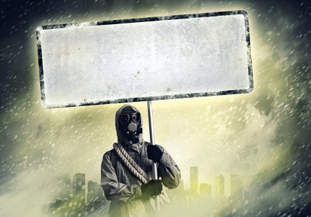 Image of stalker with blank banner against nuclear future Stock Photo - 24115684