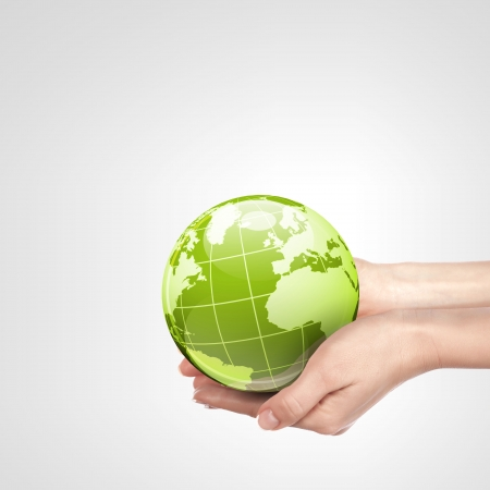 protection concept: Globe in human hand against blue sky  Environmental protection concept