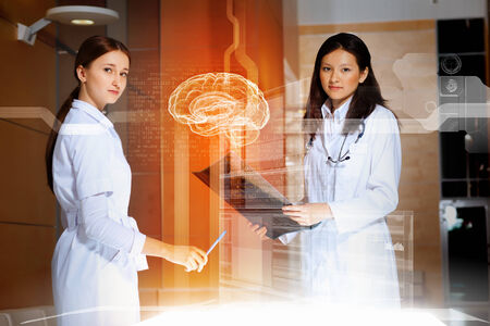 Image of two women doctors examining results photo