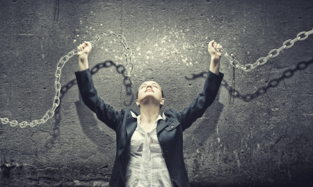 freedom girl: Image of businesswoman in anger breaking metal chain