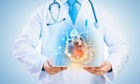 heart medical: Close up of doctor s body holding tablet pc with media illustration
