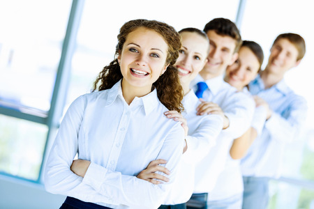 Image of young business people standing in line  Interaction concept