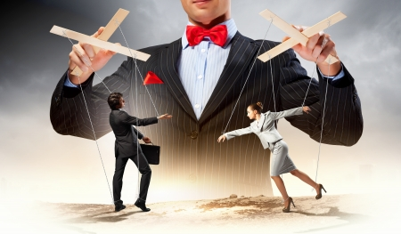 Image of young businessman puppeteer  Leadership concept Stock Photo