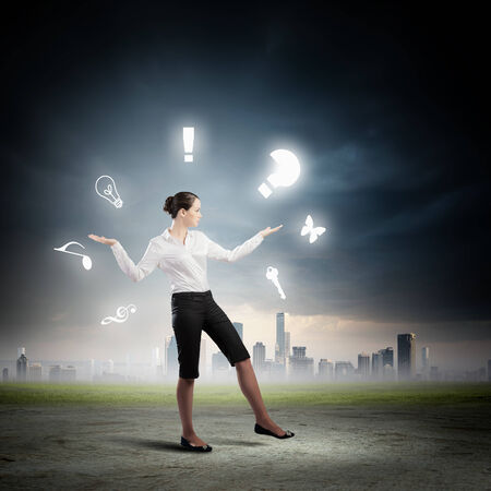 Image of businesswoman juggling with sign and symbols