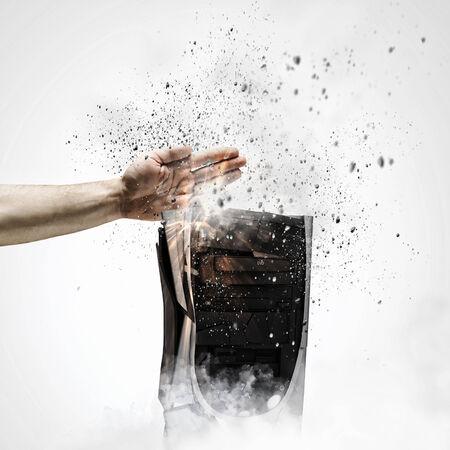 damaging: Close up image of human hand damaging computer processor