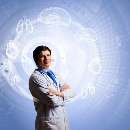 telecommunicate: Image of young thoughtful doctor looking at media screen
