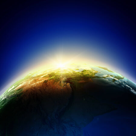Sun rising above Earth planet  Conceptual photo  Stock Photo - 24425323