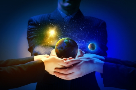 Close up image of human hands holding earth planer  Ecology concept photo