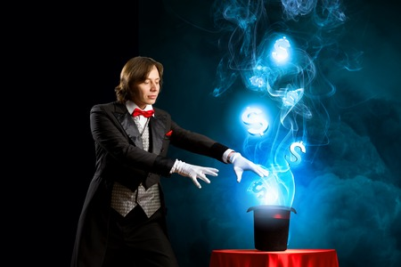 Image of wizard showing tricks with his hat  Currency concept photo