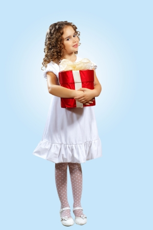 Portrait of an adorable preschool age girl wearing a Christmas holiday outfit photo