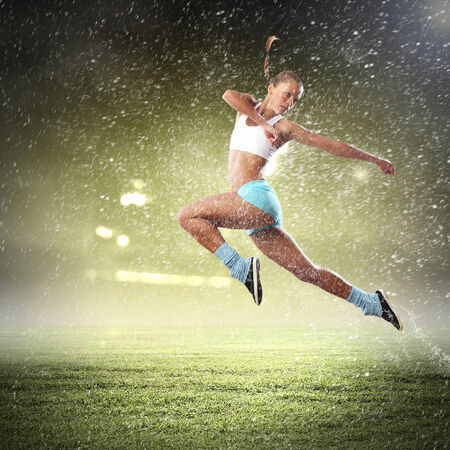 sport woman: Image of young attractive sport woman exercising Stock Photo