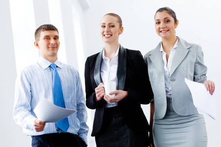 Image of three young businesspeople laughing joyfully photo