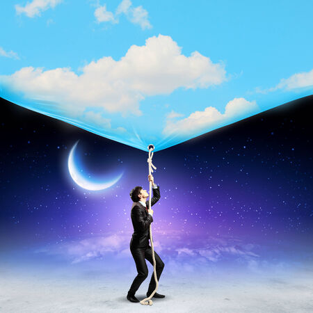 Image of businessman pulling banner with illustration  Day and night concept illustration