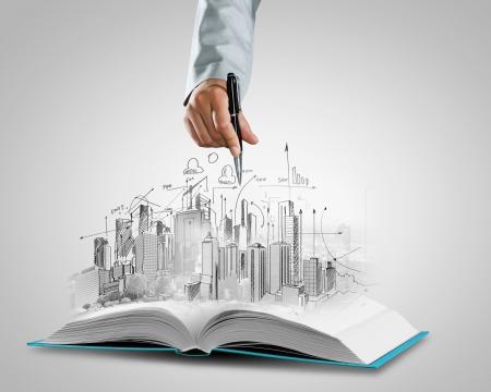 열린 된 책 및 핸드 드로잉 건물 스케치