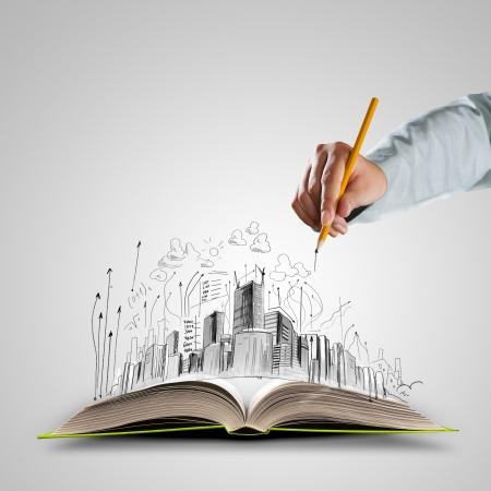 Bosquejos del libro y fomento de la mano de dibujo abiertos Foto de archivo - 24504449