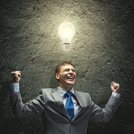 joyfully: Successful businessman screaming joyfully in to sky