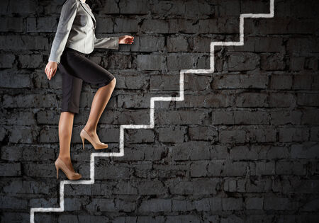corporate ladder: Image of businesswoman climbing career ladder  Success and achievement Stock Photo