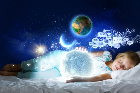 Girl lying in bed with moon in hands  photo