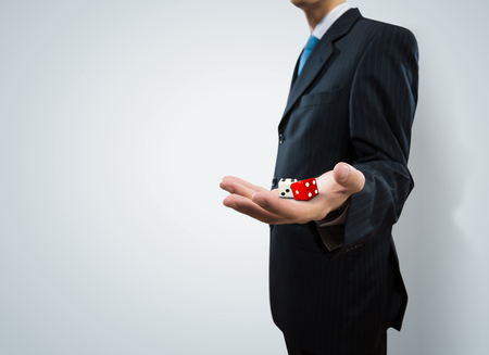 Close up of businessman throwing dice  Gambling concept