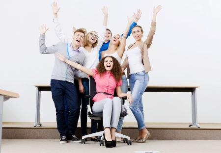 joyfully: Young happy people in classroom screaming joyfully Stock Photo