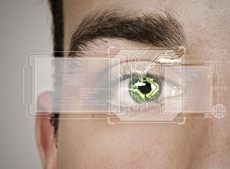 security eye: Close up of male eye scanned for recognition
