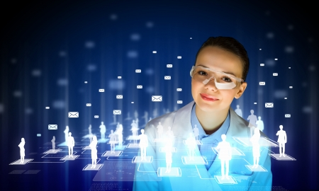 clinical research: Image of young woman scientist in goggles against media screen  Net communication Stock Photo
