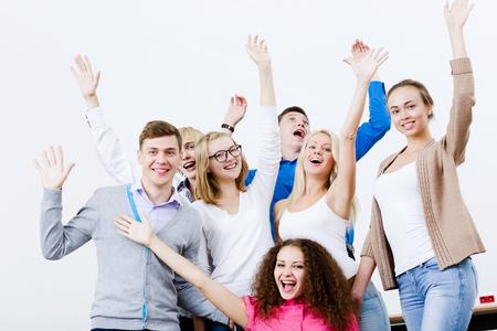 joyfully: Young happy people in classroom screaming joyfully Stock Photo