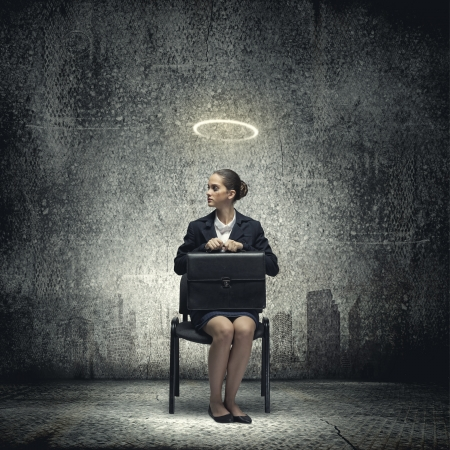 joblessness: Young crying businesswoman with halo above head Stock Photo