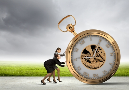 Image of attractive businesswoman and pocket watch  Time for business