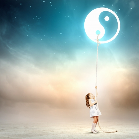 dao: Image of little girl in white dress pulling rope with dao symbol