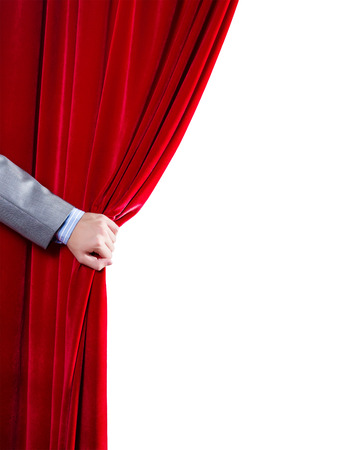 stage actors: Close up of hand opening red curtain  Place for text