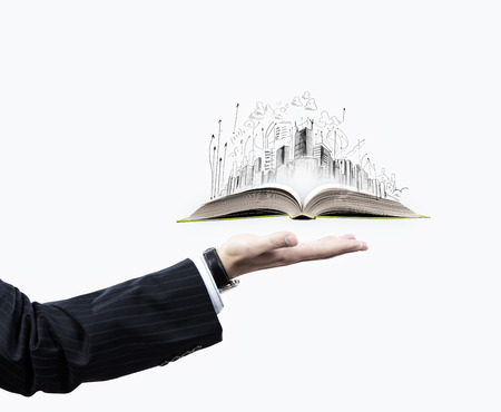land management: Businessman hand holding opened book in palm Stock Photo