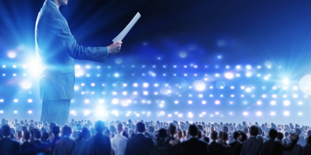 빛 연단에 사업가 스피커 서의 다시보기 스톡 콘텐츠