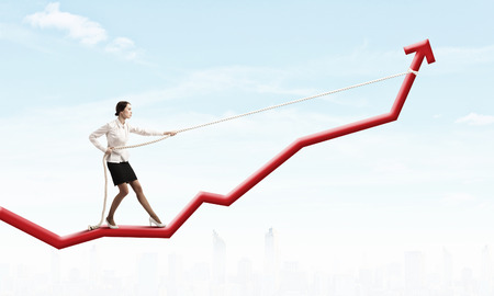 Image of businesswoman standing on graph  Income and profit Imagens