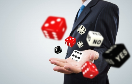 career management: Close up of businessman throwing dice  Gambling concept