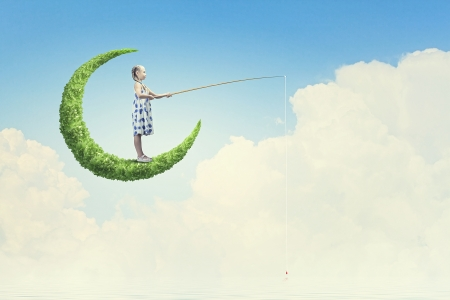 Little girl standing on moon and fishing photo