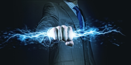 satan: Businessman holding lightning in fist  Power and control