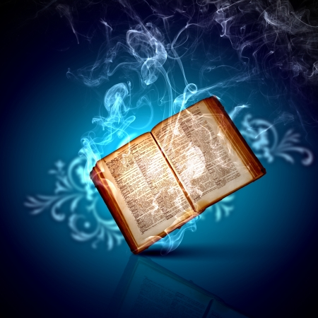 Image of opened magic book with magic lights Stock Photo